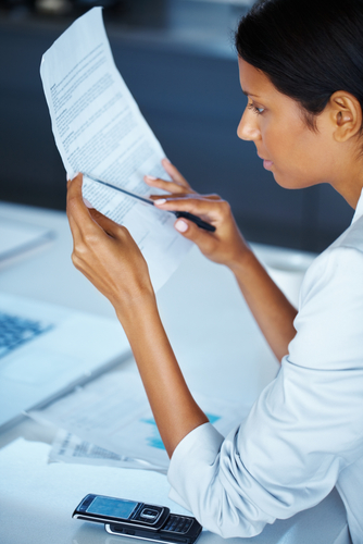 side_view_of_business_woman_reviewing_contract.jpg
