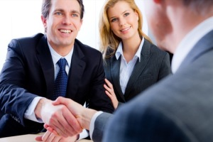 95322156-attorney-clients-shacking-hands-deal-contract-negotiations-300x200