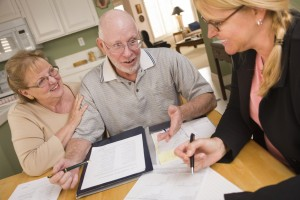 stockfresh_2776410_senior-adult-couple-going-over-papers-in-their-home-with-agent_sizeS-300x200
