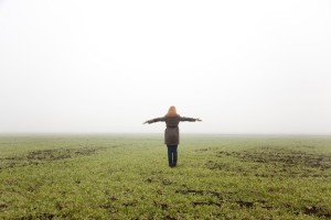 stockfresh_867429_girl-at-spring-field-in-fog-time_sizeS-300x200