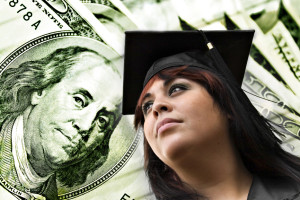 A closeup of a female graduate in her cap and gown in front of a money background. Great conceptual image for scholarships college loans or projected career earnings.