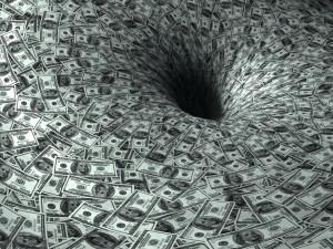 stockfresh_368884_dollar-flow-in-black-hole_sizeS