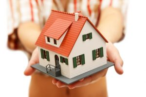 Model house in woman's hand