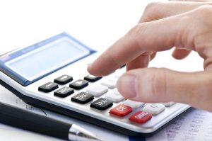 stockfresh_121705_tax-calculator-and-pen_sizeS-300x199