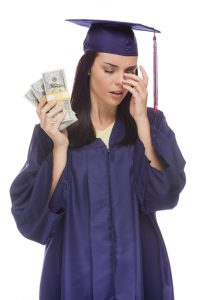 stockfresh_3576539_stressed-female-graduate-holding-stacks-of-hundred-dollar-bills_sizeS-200x300