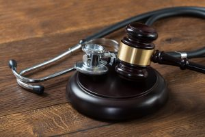 stockfresh_6387113_gavel-and-stethoscope-on-table_sizeS-300x200
