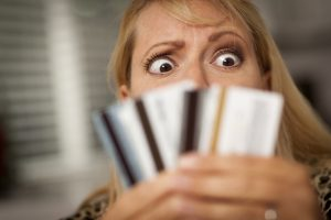 stockfresh_1211123_upset-woman-glaring-at-her-many-credit-cards_sizeS-300x200