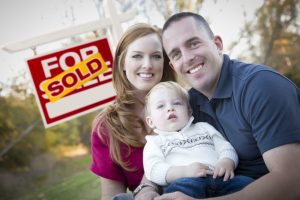 stockfresh_1676251_happy-young-family-in-front-of-sold-real-estate-sign_sizeS-300x200