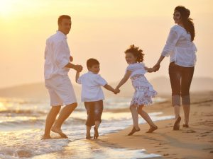 stockfresh_1018858_happy-young-family-have-fun-on-beach-at-sunset_sizeS-300x225