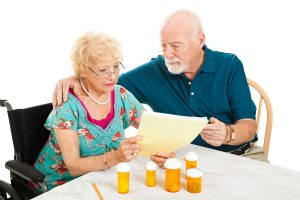 stockfresh_1532919_senior-couple-medical-bills_sizeS-300x200