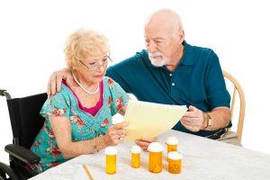 stockfresh_1532919_senior-couple-medical-bills_sizeS-300x200