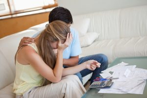 stockfresh_2581878_sad-couple-in-financial-trouble-in-their-living-room_sizeS-300x200
