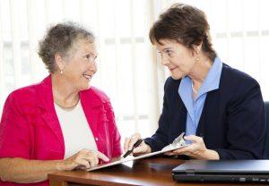 stockfresh_210865_mature-businesswomen-discuss-contract_sizeS-300x208