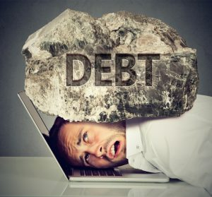 stockfresh_7501032_man-squeezed-between-laptop-and-rock-student-loan-debt-concept_sizeS-300x279