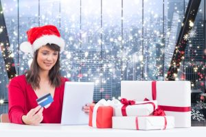 stockfresh_6129921_composite-image-of-festive-brunette-shopping-online-with-tablet_sizeS-300x200