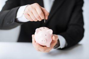 stockfresh_3231743_man-putting-coin-in-small-piggy-bank_sizeS-300x200
