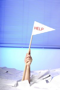 stockfresh_356578_hand-with-help-flag-sticking-out-of-papers_sizeL-201x300