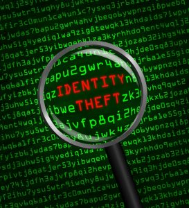 stockfresh_3962479_identity-theft-revealed-in-computer-code-through-a-magnifying-gl_sizeS-273x300