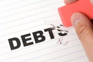 stockfresh_225020_eraser-and-word-debt_sizeS-300x200