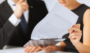 stockfresh_3433722_man-and-woman-signing-contract-paper_sizeS-e1571863295931-300x179