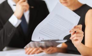 stockfresh_3433722_man-and-woman-signing-contract-paper_sizeS-e1578694746271-300x183