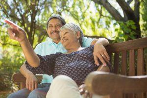stockfresh_8337903_senior-couple-pointing-to-a-distance_sizeS-300x200